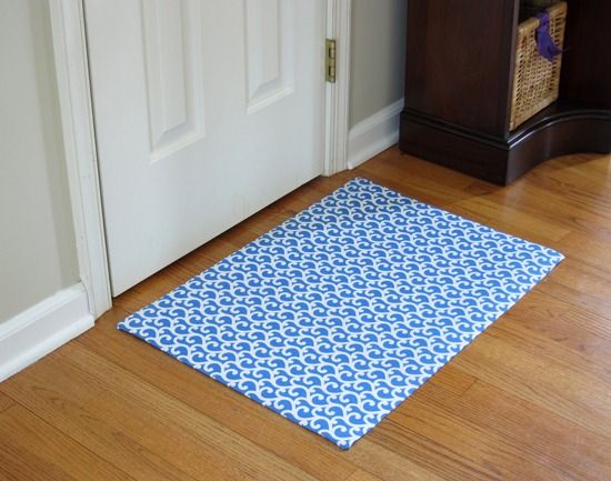 Fabric Covered Vinyl Rug
